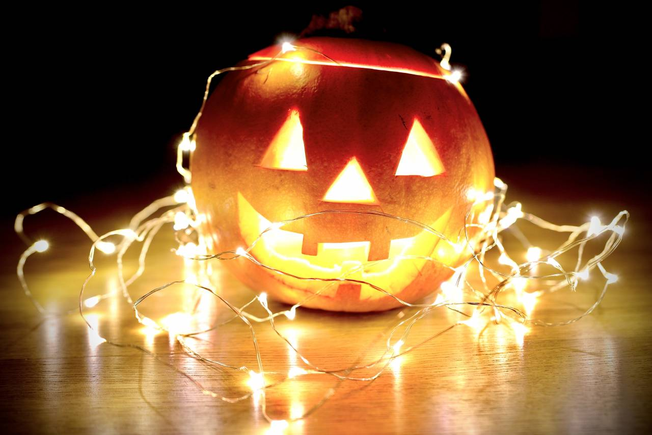 lighted string lights wrapped on Jack-O'-Lantern